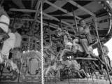 Riding on the Merry-Go-Round Carousel at a Surrey Funfair Photographic Print by Vanessa Wagstaff