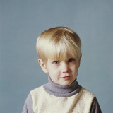 Portrait of Boy on Blue Background Photographic Print by Dennis Hallinan
