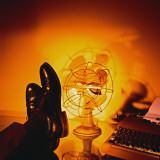Feet Resting on Desk with Vintage Fan and Typewriter Photographic Print by Wendy Idele