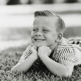 Portrait of Boy with Freckles Smiling on Grass Photographic Print by Dennis Hallinan