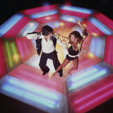 Couple Disco Dancing on Colorful Dance Floor Photographic Print by Dennis Hallinan