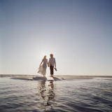 Wedding Couple on a Beach Photographic Print by Dennis Hallinan