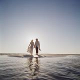 Wedding Couple on a Beach Photographic Print by Dennis Hallinan