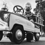 Young Boy Playing with Toy Fire Truck Photographic Print by Dennis Hallinan