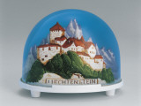 Close-Up of a Figurine of a Castle on a Mountain in a Snow Globe Photographic Print