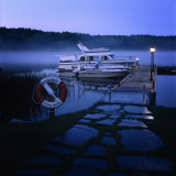 Two Boats Moored by a Dock of a Lake Photographie par Urban Joren
