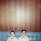 Brothers Smiling Wearing Bowties in Retro Living Room Photographic Print by Rob Lang