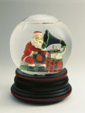 Close-Up of a Figurine of a Santa Claus Listening to a Gramophone in a Snow Globe Photographic Print