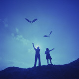 Couple Flying Kites on Top of a Hill Photographic Print by Dennis Hallinan