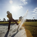Golfer Hitting Ball Out of Sand Trap Photographic Print by Dennis Hallinan