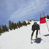 Skier in Slalom Ski Race (Blurred Motion) Photographic Print by Mike Powell