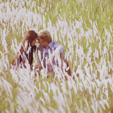 Loving Couple Laying Amongst Tall Grass Photographic Print by Dennis Hallinan