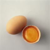 High Angle View of an Egg with a Broken Egg Photographic Print by M. Sarcina