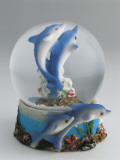 Close-Up of Figurines of Dolphins in a Snow Globe Photographic Print