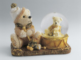 Close-Up of a Teddy Bear with a Snow Globe Photographic Print