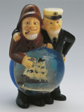 Close-Up of Figurines of Sailors with a Snow Globe Photographic Print