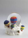 Close-Up of a Figurine of a Hot Air Balloon in a Snow Globe Photographic Print