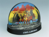 Close-Up of Figurines of Native American Horseback Riders in a Snow Globe Photographic Print