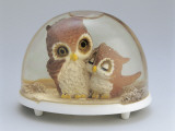 Close-Up of Figurines of a Pair of Owls in a Snow Globe Photographic Print