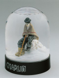 Close-Up of a Figurine of Charlie Chaplin in a Snow Globe Photographic Print