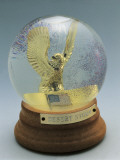 Close-Up of a Figurine of an Eagle in a Snow Globe Photographic Print