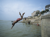 Man Jumping into Ganges River , Varanasi, India Photographic Print by Ami Vitale