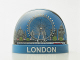 Close-Up of Figurines of a Ferris Wheel in Front of Landmarks in a Snow Globe Photographic Print