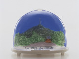 Close-Up of a Figurine of the Puy-De-Dome Volcano in a Snow Globe Photographic Print