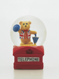 Close-Up of a Figurine of a Teddy Bear Holding an Umbrella and a Hat in a Snow Globe Photographic Print