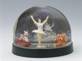 Close-Up of Figurines of a Ballet Dancer with a Teddy Bear and a Rocking Horse in a Snow Globe Photographic Print