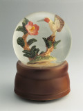 Figurine of a Hummingbird with a Flower in a Snow Globe Photographic Print