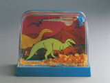 Close-Up of Figurines of Dinosaurs in a Snow Globe Photographic Print