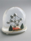 Close-Up of a Figurine of an Atom in a Snow Globe Photographic Print