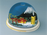 Close-Up of a Figurine of Mt Fuji in a Snow Globe Photographic Print
