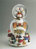 Close-Up of a Snowman and a Santa Claus in a Snow Globe Photographic Print