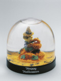 Close-Up of a Figurine of a Witch in a Snow Globe Photographic Print