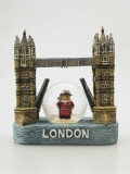Close-Up of a Tower Bridge Shaped Snow Globe with a Figurine of a Beefeater Photographic Print