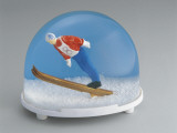 Close-Up of a Figurine of a Skier in a Snow Globe Photographic Print