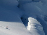 Lone Skier on Immense Glacier Photographic Print by Andrew Castellano
