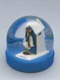 Close-Up of a Figurine of a Security Guard Standing in Front of a Figurine of Hut in a Snow Globe Photographic Print