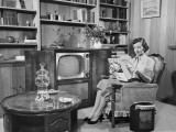Woman Sitting in Armchair, Reading Magazine Photographic Print by George Marks