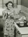 Portrait of Young Woman in Kitchen Holding Can of Soup Photographic Print by George Marks
