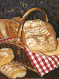 High Angle View of Loafs of Bread in a Basket Photographic Print by C. Sappa