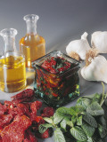 Close-Up of Vegetables and Oil in Bottles Photographic Print by N. Banas