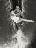 Couple Performs Waterskiing Stunt Photographic Print by Dennis Hallinan