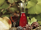 Close-Up of a Glass and a Jug of Red Wine with Bunches Red Grapes Photographic Print by G. Cigolini