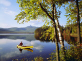 Man Paddles Canoe on Autumn Day Photographic Print by Dennis Hallinan