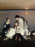 Happy Retro Family Roasting Hot Dogs over Fire Photographic Print by Dennis Hallinan