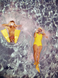 Couple Diving in Swimming Pool Photographic Print by Dennis Hallinan