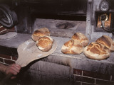 Close-Up of a Person's Hand Baking Bread Photographic Print by C. Sappa